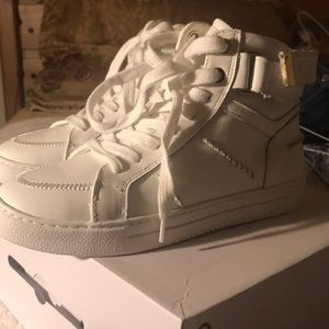 Clean white high top sneakers